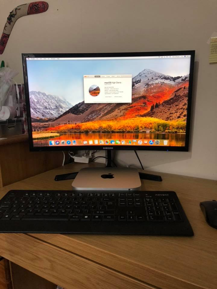 Mac Mini, monitor with wireless keyboard and mouse
